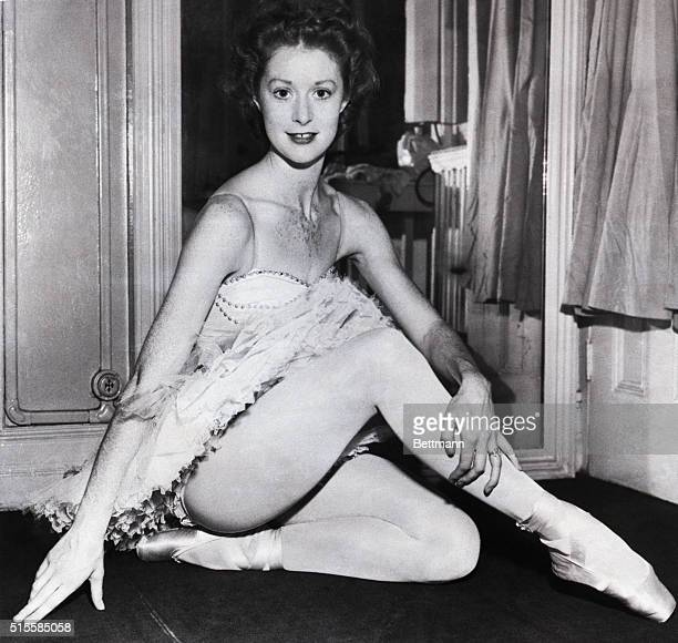 Moira Shearer ballet dancer and actress sits on the floor in a tutu with her legs crossed