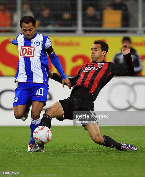 Moise Bambara of Ingolstadt fights for the ball with Raffael of Hertha BSC during the second Bundesliga match between FC Ingolstadt and Hertha BSC...