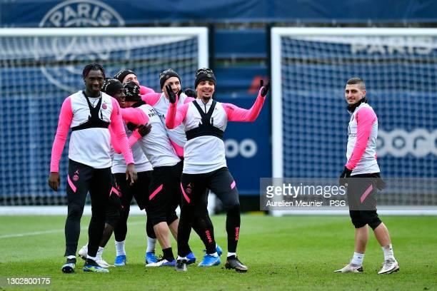 Moise Kean, Layvin Kurzawa and Marco Verratti react during a Paris Saint-Germain training session on February 18, 2021 in Paris, France.