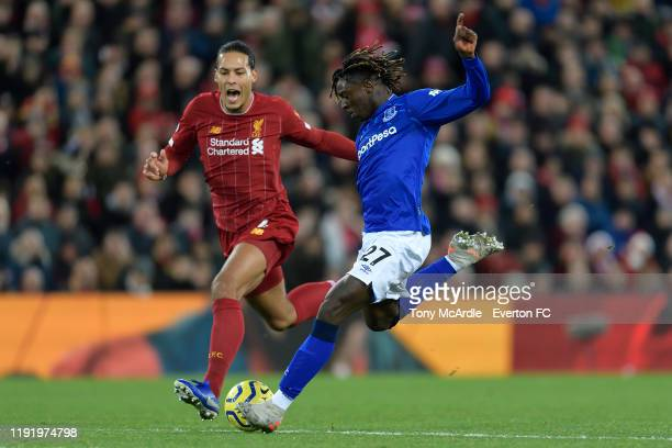 Moise Kean of Everton and Virgil van Dijk challenge for the ball during the Premier League match between Liverpool and Everton at Anfield on December...