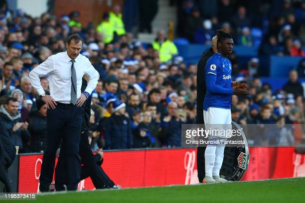 Moise Kean of Everton waits on the touchline as manager Duncan Ferguson looks on during the Premier League match between Everton FC and Arsenal FC at...
