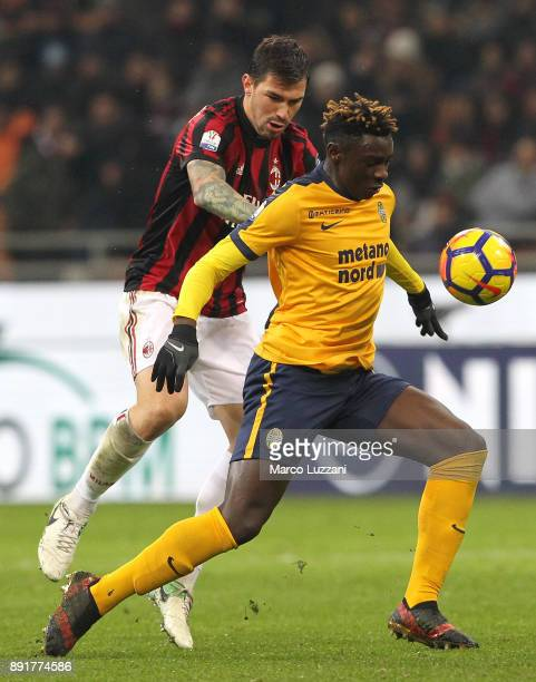 Moise Kean of Hellas Verona FC competes for the ball with Alessio Romagnoli of AC Milan during the Tim Cup match between AC Milan and Hellas Verona...