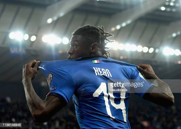 Moise Kean of Italy celebrates after scoring the second goal during the 2020 UEFA European Championships group J qualifying match between Italy and...