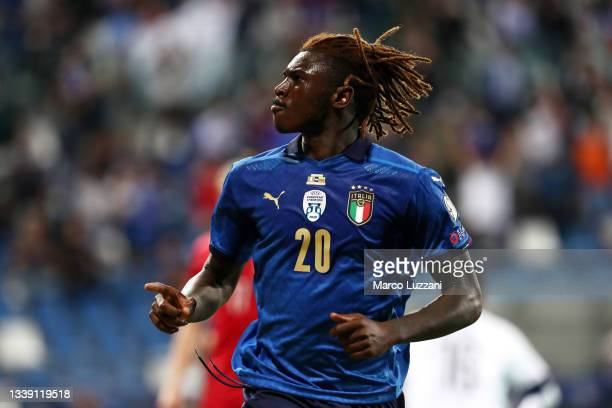 Moise Kean of Italy celebrates after scoring their side's fourth goal during the 2022 FIFA World Cup Qualifier match between Italy and Lithuania at...