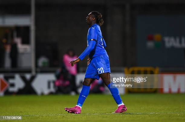 Moise Kean of Italy leaves the field after receiving a red card during the UEFA U21 Championships Qualifier match between the Republic of Ireland and...