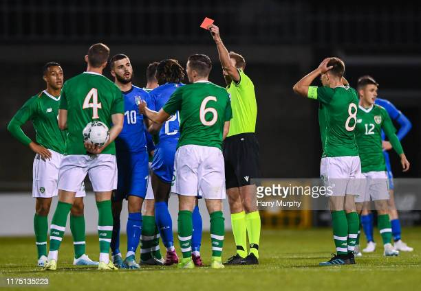 Moise Kean of Italy receives a red card from referee Sascha Stegemann during the UEFA U21 Championships Qualifier match between the Republic of...