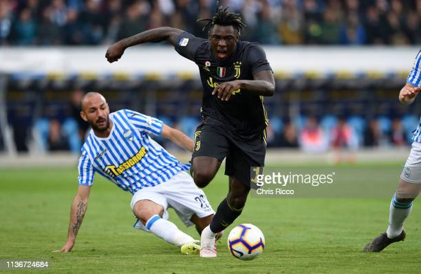 Moise Kean of Juventus gets away from Pasquale Schiattarella of SPAL during the Serie A match between SPAL and Juventus at Stadio Paolo Mazza on...