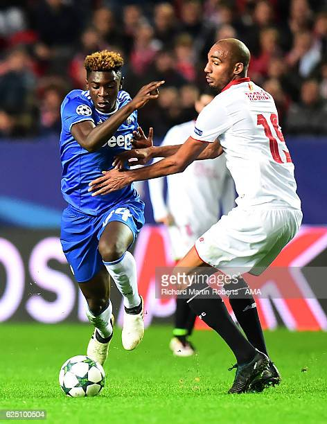 Moise Kean of Juventus is challenged by Steven N'Zonzi of Sevilla during the UEFA Champions League match between Sevilla FC and Juventus at Estadio...