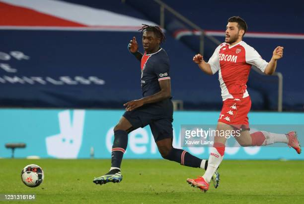Moise Kean of Paris Saint Germain in action with Kevin Volland of AS Monaco during the Ligue 1 soccer match between Paris Saint-Germain and AS Monaco...