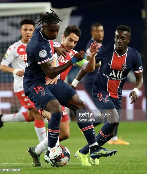 Moise Kean of Paris Saint Germain in action with Wissam Ben Yedder of AS Monaco during the Ligue 1 soccer match between Paris Saint-Germain and AS...