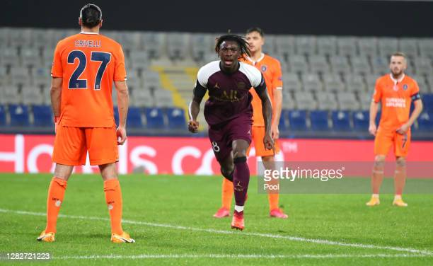 Moise Kean of Paris Saint-Germain celebrates after scoring his team's first goal during the UEFA Champions League Group H stage match between...