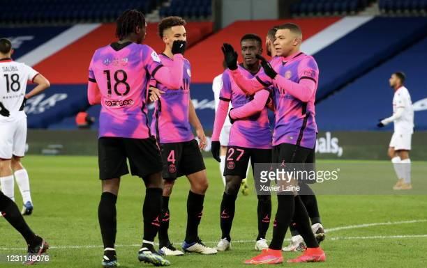 Moise Kean of Paris Saint-Germain celebrates his goal with teammattes during the Ligue 1 match between Paris Saint-Germain and OGC Nice at Parc des...