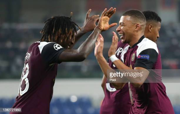 Moise Kean of Paris Saint-Germain celebrates with Kylian Mbappe after scoring his team's first goal during the UEFA Champions League Group H stage...