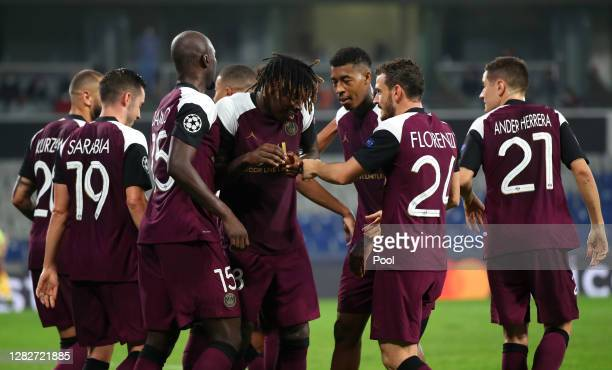 Moise Kean of Paris Saint-Germain celebrates with team mates after scoring his team's first goal during the UEFA Champions League Group H stage match...