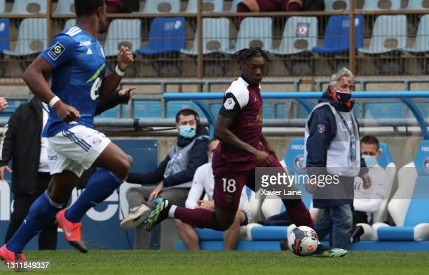 Moise Kean of Paris Saint-Germain in action during the Ligue 1 match between Strasbourg and Paris at Stade de la Meinau on April 10, 2021 in...