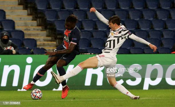 Moise Kean of Paris SaintGermain in action with Victor Lindelof of Manchester United during the UEFA Champions League Group H stage match between...