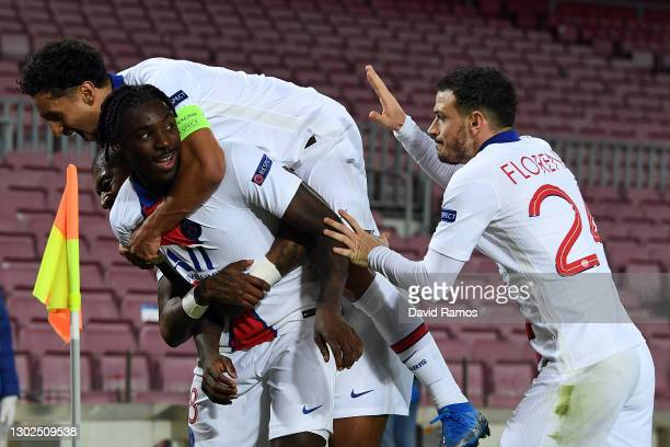 Moise Keane of Paris Saint-Germain celebrates with team mates Marquinhos and Alessandro Florenzi after scoring their side's third goal during the...