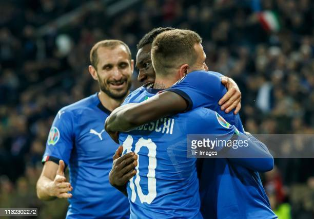 MoiseKean of Italy celebrates after scoring his team's second goal with team mates during the 2020 UEFA European Championships group J qualifying...