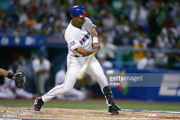 Moises Alou of the Dominican Republic bats against Puerto Rico during the second round of the World Baseball Classic at Hiram Bithorn Stadium on...