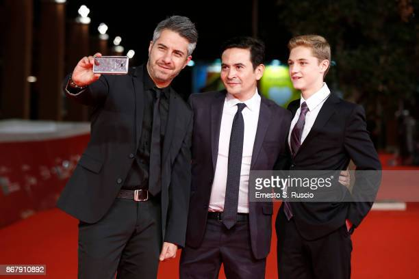 Moises Arizmendi Alejandro Andrade Pease and Emilio Puente walk a red carpet for 'Cuernavaca' during the 12th Rome Film Fest at Auditorium Parco...