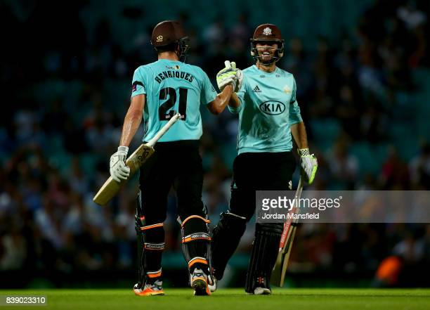 Moises Henriques and Ben Foakes of Surrey shake hands at the end of their innings during the NatWest T20 Blast QuarterFinal between Surrey and...