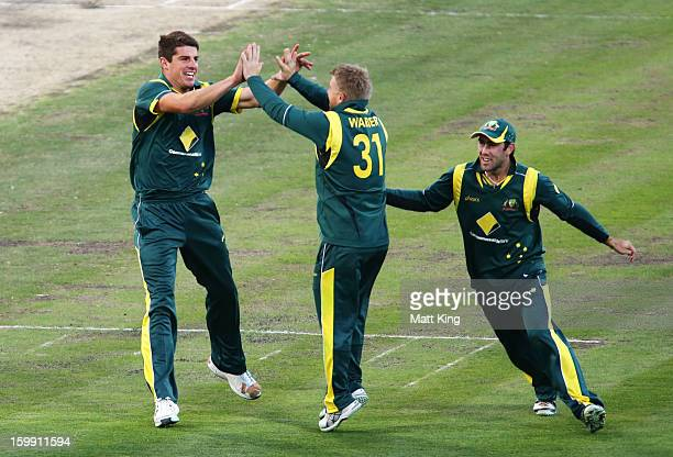 Moises Henriques of Australia celebrates with David Warner and Trent Maxwell after taking the wicket of Tillakaratne Dilshan of Sri Lanka during game...