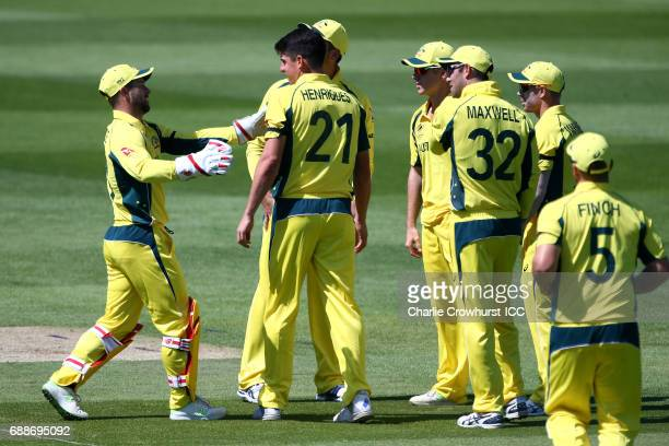 Moises Henriques of Australia celebrates with team mates after taking the wicket of Niroshan Dickwella during the ICC Champions Trophy Warmup match...
