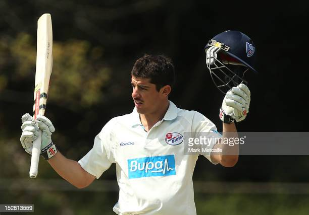 Moises Henriques of New South Wales celebrates scoring a 150 during day two of the Sheffield Shield match between the New South Wales Blues and the...