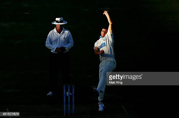 Moises Henriques of the Blues bowls during day two of the Sheffield Shield match between the New South Wales Blues and the Queensland Bulls at Sydney...