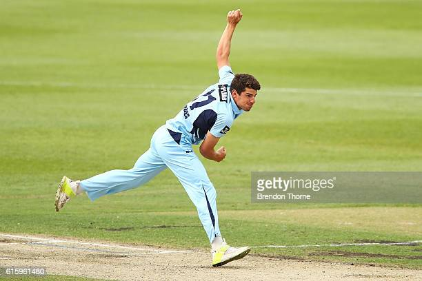Moises Henriques of the Blues bowls during the Matador BBQs One Day Cup match between New South Wales and Victoria at Drummoyne Oval on October 21...