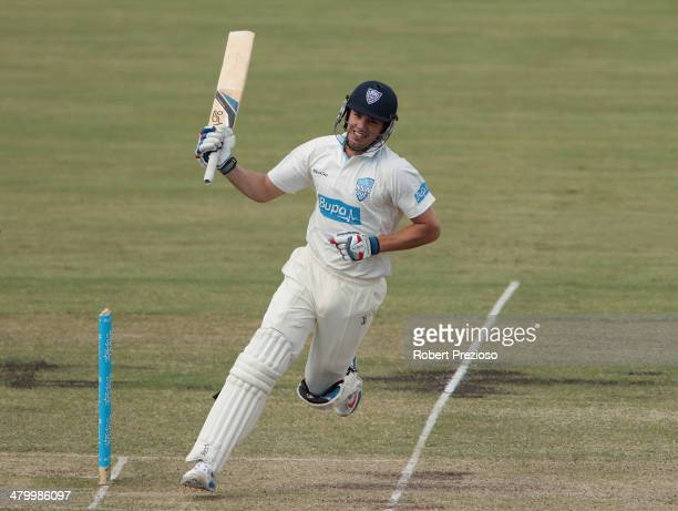 Moises Henriques of the Blues celebrates after scoring his century during day two of the Sheffield Shield match between New South Wales Blues and the...