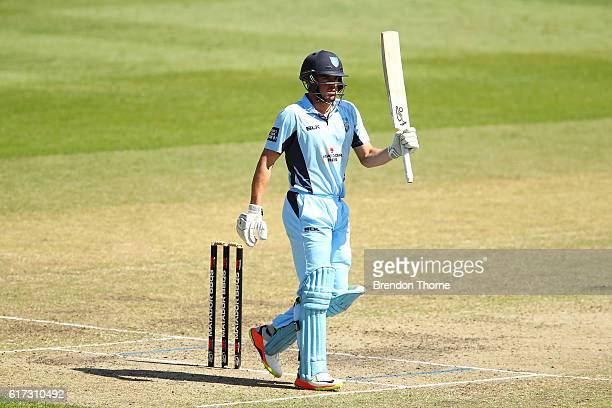 Moises Henriques of the Blues celebrates scoring his half century during the Matador BBQs One Day Cup Final match between Queensland and New South...