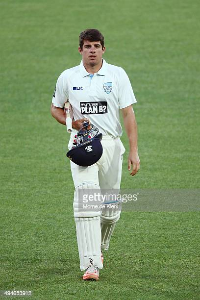 Moises Henriques of the Blues leave the field after getting out to Joe Mennie of the Redbacks during day one of the Sheffield Shield match between...