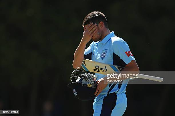 Moises Henriques of the Blues leaves the field after being dismissed during the Ryobi Cup match between the New South Wales Blues and the Tasmania...