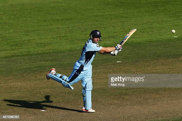 Moises Henriques of the Blues plays on the on side for four during the Matador BBQs One Day Cup match between Victoria and New South Wales at North...