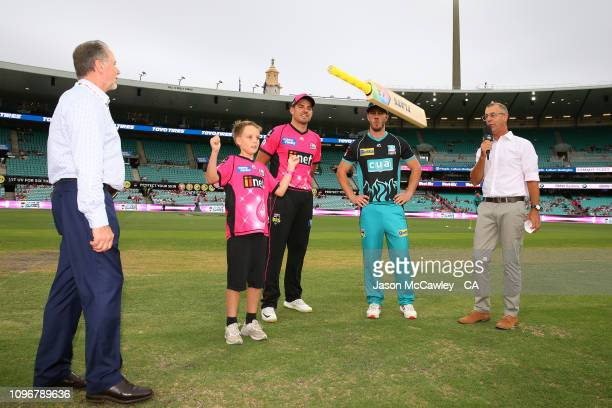 Moises Henriques of the Sixers and Chris Lynn of the Heat takes part in the bat toss prior to the Big Bash League match between the Sydney Sixers and...