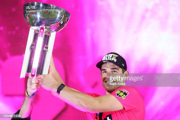 Moises Henriques of the Sixers celebrates victory as he holds up the trophy after the Big Bash League Final match between the Sydney Sixers and the...