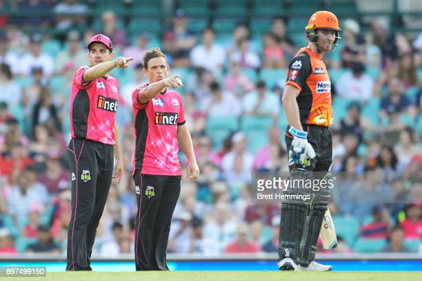 Moises Henriques of the Sixers directs players with Stephen O'Keefe of the Sixers during the Big Bash League match between the Sydney Sixers and the...