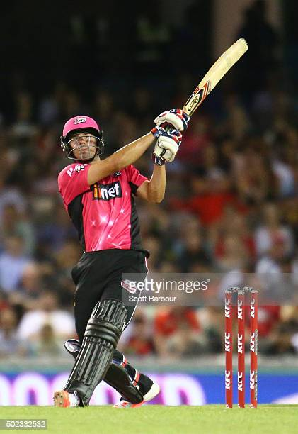 Moises Henriques of the Sixers hits a six during the Big Bash League match between the Melbourne Renegades and the Sydney Sixers at Etihad Stadium on...