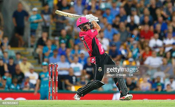Moises Henriques of the Sixers hits a six during the super over during the Big Bash League semi final match between the Brisbane Heat and the Sydney...