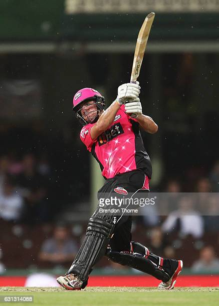 Moises Henriques of the Sixers hits for six during the Big Bash League match between the Sydney Sixers and the Melbourne Renegades at Sydney Cricket...