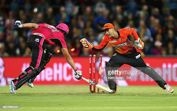 Moises Henriques of the Sixers is run out by Sam Whiteman of the Scorchers during the Big Bash League final match between the Sydney Sixers and the...