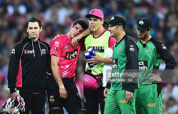 Moises Henriques of the Sixers reacts after suffering an injury while batting during the Big Bash League match between the Sydney Sixers and the...