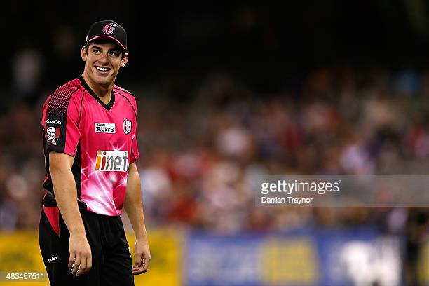 Moises Henriques of the Sixers reacts to the crowd during the Big Bash League match between the Melbourne Renegades and the Sydney Sixers at Etihad...
