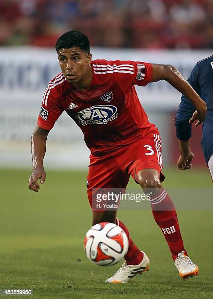 Moises Hernandez of FC Dallas steals the ball from Teal Bunbury of New England Revolution at Toyota Stadium on July 19 2014 in Frisco Texas