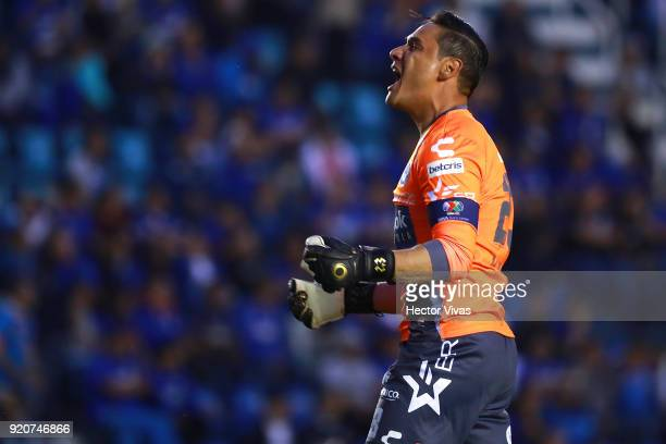 Moises Munoz goalkeeper of Puebla celebrates after teammate Francisco Acuña scored the equalizer during the 8th round match between Cruz Azul and...