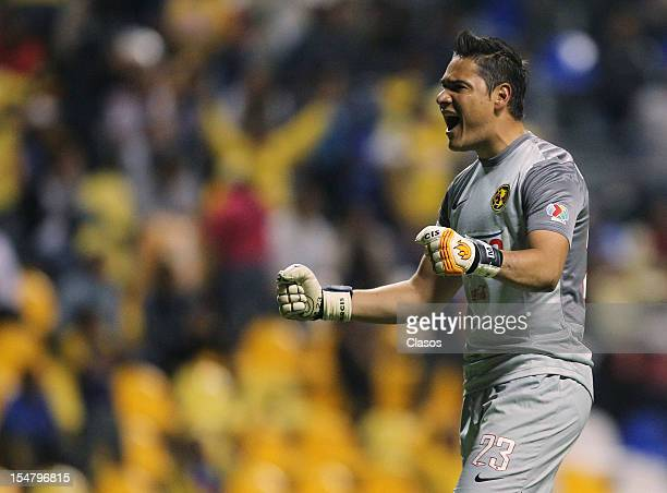 Moises Munoz of America celebrates a scored goal during a match between Puebla v America as part of the Apertura 2012 Liga Mx at Cuauhtemoc Stadium...