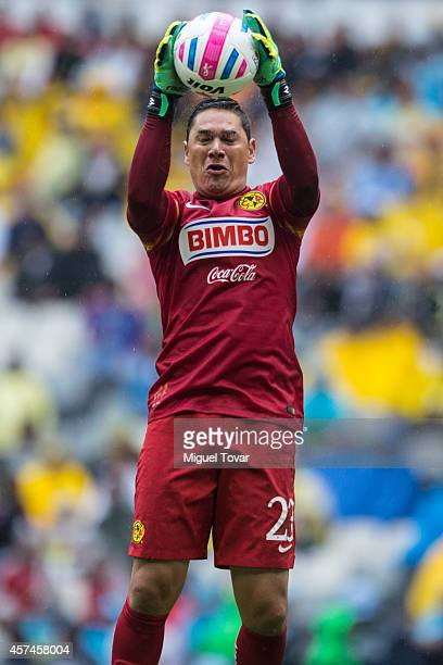 Moises Munoz of America jumps for the ball during a match between America and Monterrey as part of 13th round Apertura 2014 Liga MX at Azteca Stadium...
