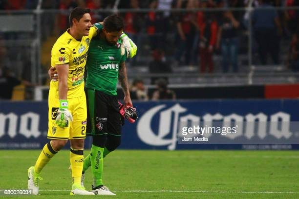 Moises Muñoz goalkeeper of Chiapas and Miguel Fraga goalkeeper of Atlas leave the field after the 17th round match between Atlas and Chiapas as part...
