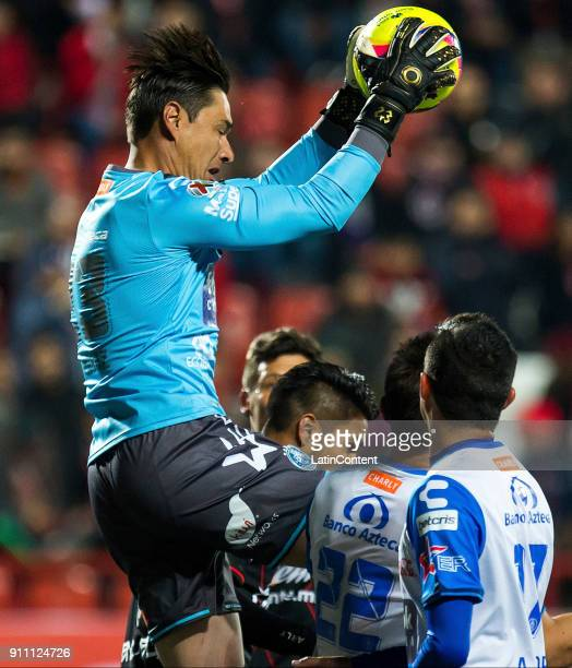 Moises Muñoz goalkeeper of Puebla jumps to catch the ball during the 4th round match between Tijuana and Puebla as part of the Torneo Clausura 2018...